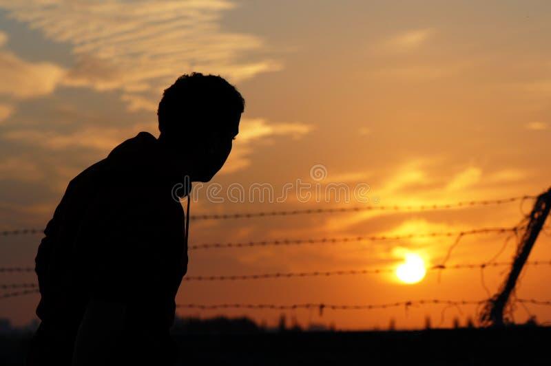 Gefangener am Sonnenuntergang stockfotografie