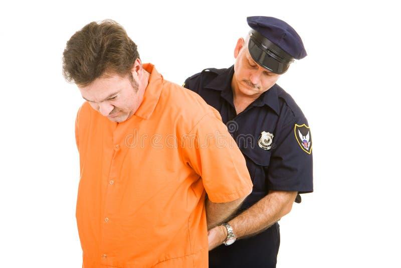 Gefangener und Polizeibeamte lizenzfreies stockfoto