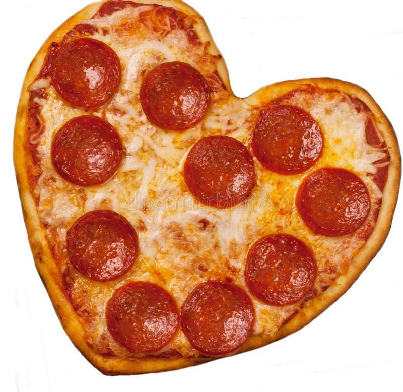 Geformte Pizza des Herzens für Valentinstag lizenzfreies stockbild