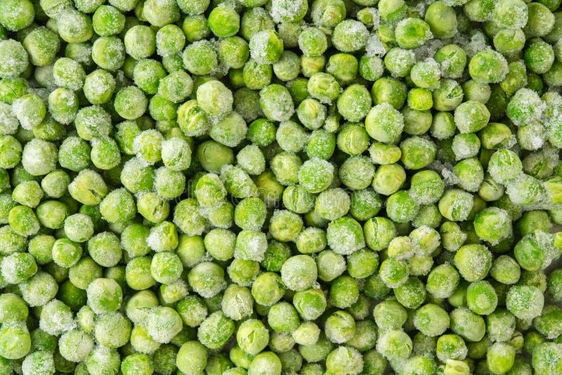 Gefrorene grüne Erbsen schließen herauf Draufsicht sehr viele Fleischmehlkl??e stockbild