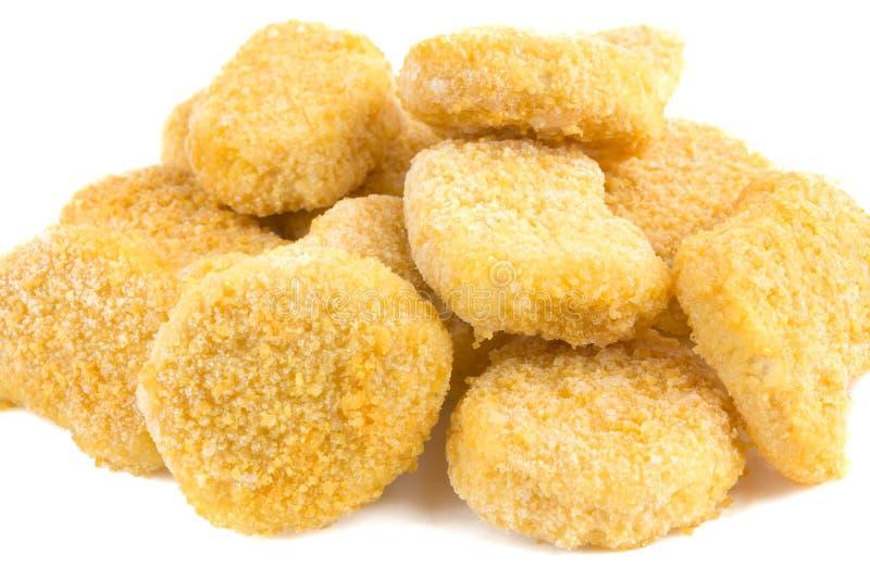 Gefrorene Nuggets auf einem wei?en Hintergrund stockbild