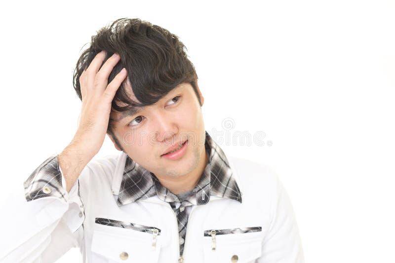 Gefrustreerde Aziatische Mens stock foto
