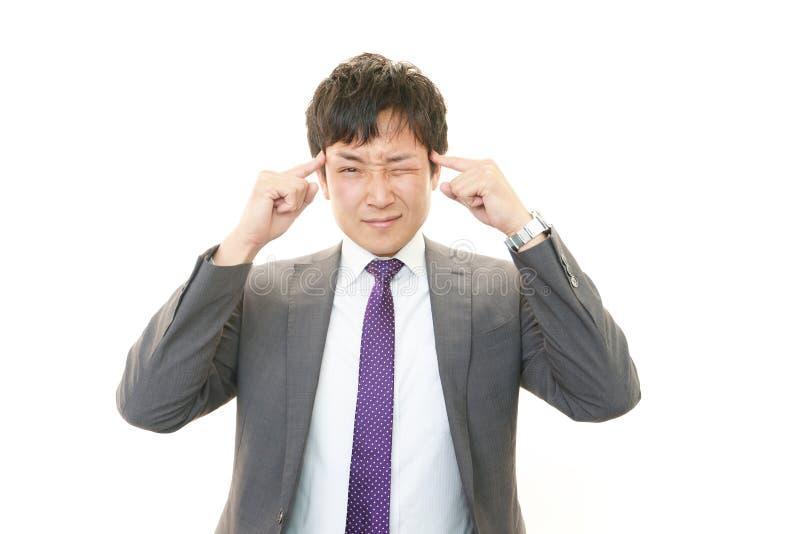 Gefrustreerde Aziatische zakenman royalty-vrije stock afbeelding