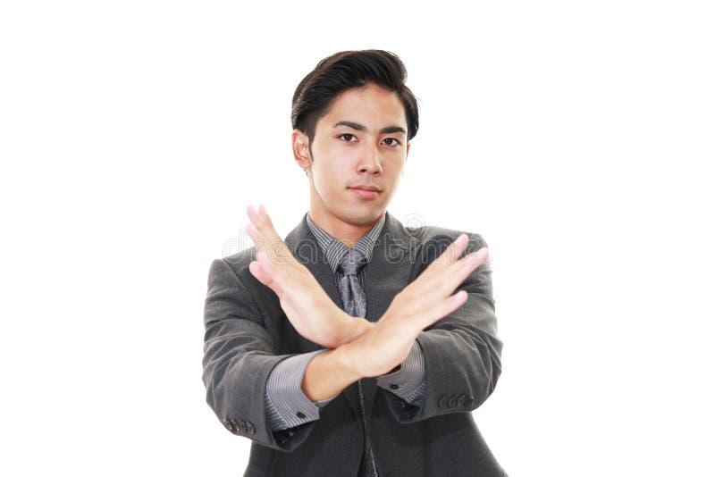 Gefrustreerde Aziatische zakenman stock afbeeldingen
