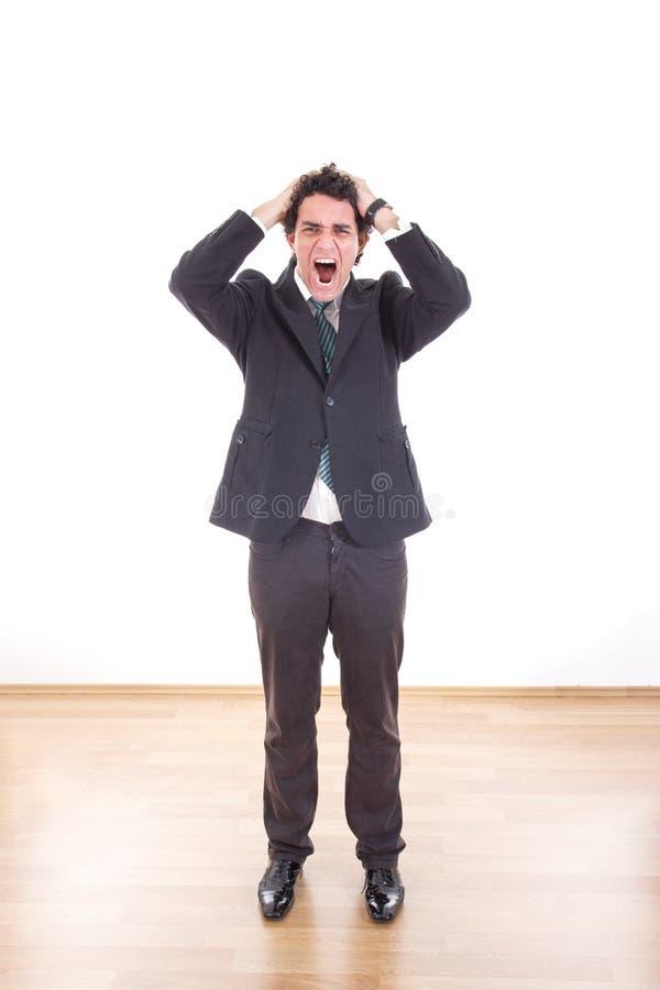 Gefrustreerde en gedeprimeerde zakenman met hoofdpijn die zijn h houden royalty-vrije stock foto's