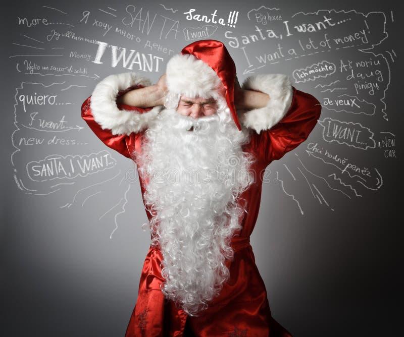 Gefrustreerde Santa Claus en vele wensen royalty-vrije stock afbeelding