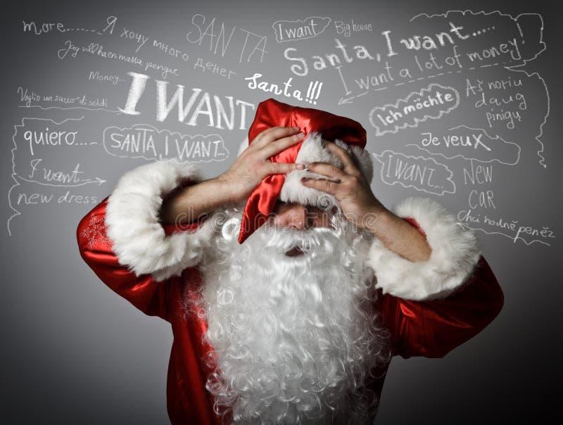 Gefrustreerde Santa Claus en vele wensen royalty-vrije stock foto