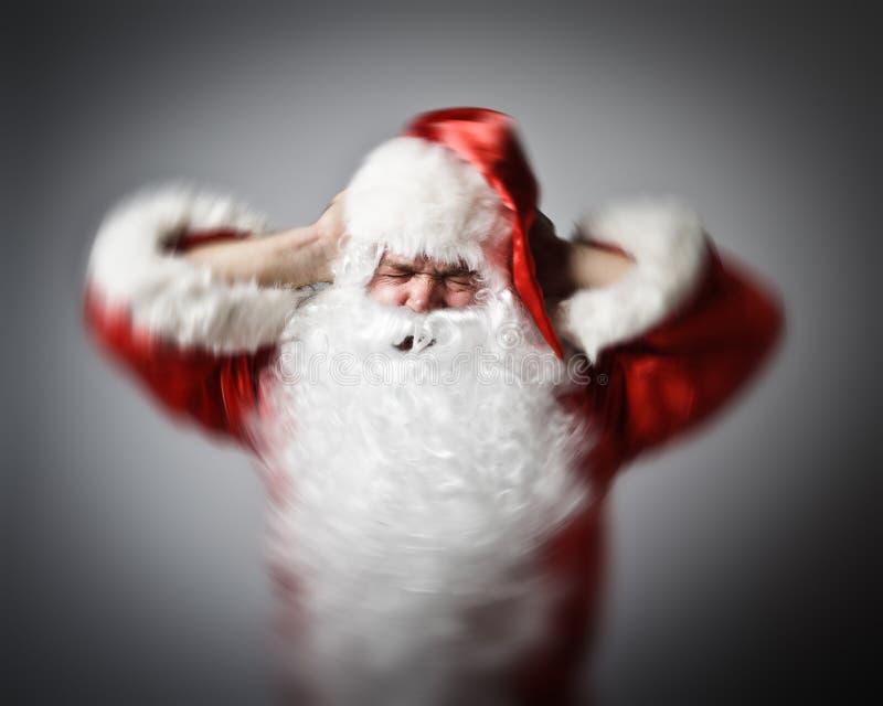 Gefrustreerde Santa Claus migraineconcept stock afbeeldingen