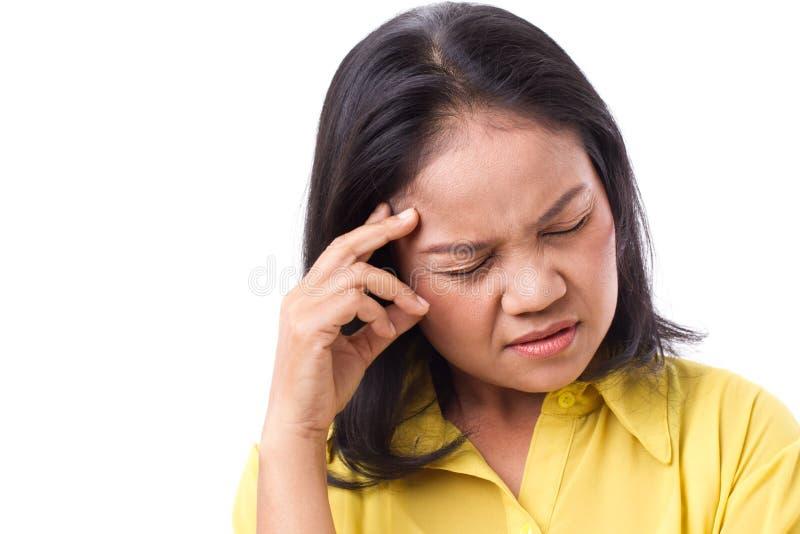 Gefrustreerde vrouw die aan hoofdpijn of spanning met scherpe scherpe pijn lijden stock foto's