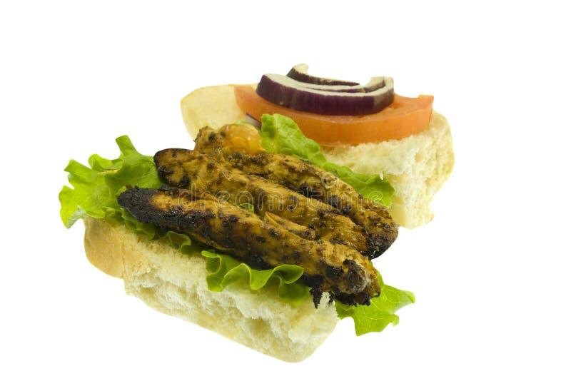 Gegrilltes belegtes Brot mit Hühnerfleisch auf Weiß lizenzfreie stockfotos