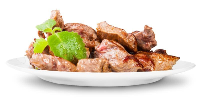 Gegrilltes Fleisch auf einer weißen Platte gedreht gedient mit tadellosem Blatt stockfotografie