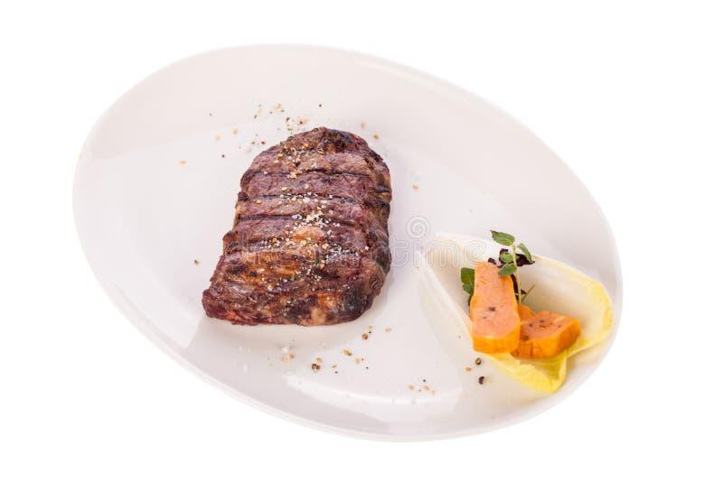Gegrilltes Rindfleischsteak mit Gewürz lizenzfreies stockbild