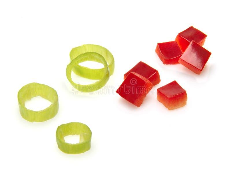 Gehackte rote und grüne Pfeffer lizenzfreies stockbild