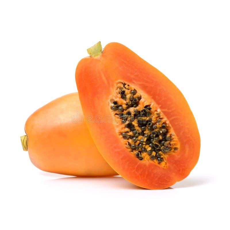Gehalveerde en gehele papajavruchten royalty-vrije stock fotografie