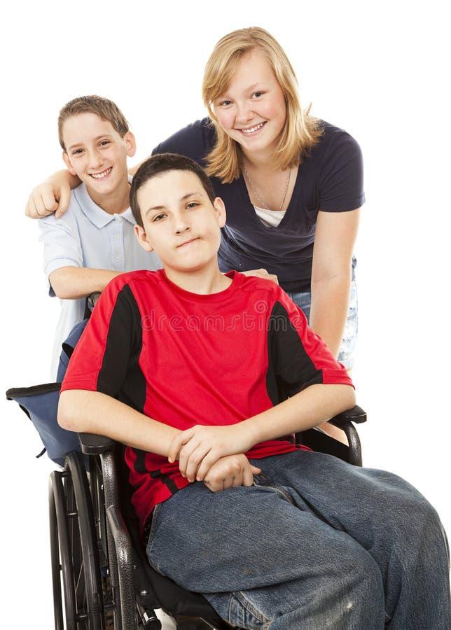 Gehandicapte Jongen en Siblings stock afbeelding