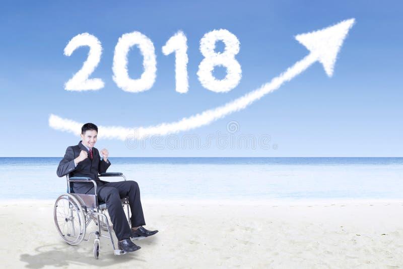 Gehandicapte zakenman met nummer 2018 stock afbeelding
