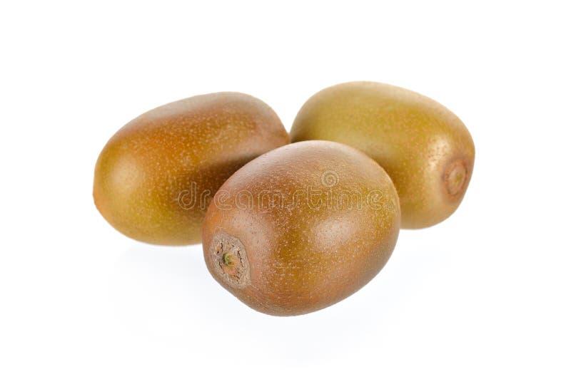 Geheel rijp gouden kiwifruit op witte achtergrond stock afbeeldingen