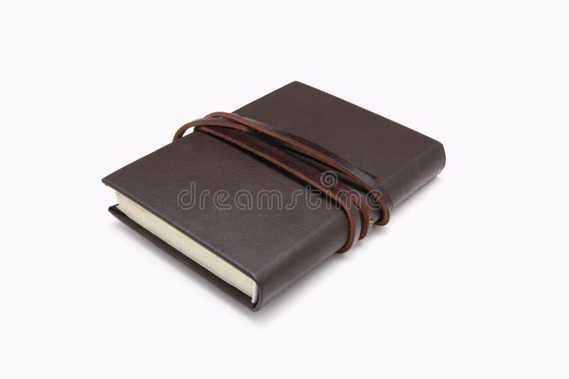 Geheim bruin leerboek met witte achtergrond stock fotografie