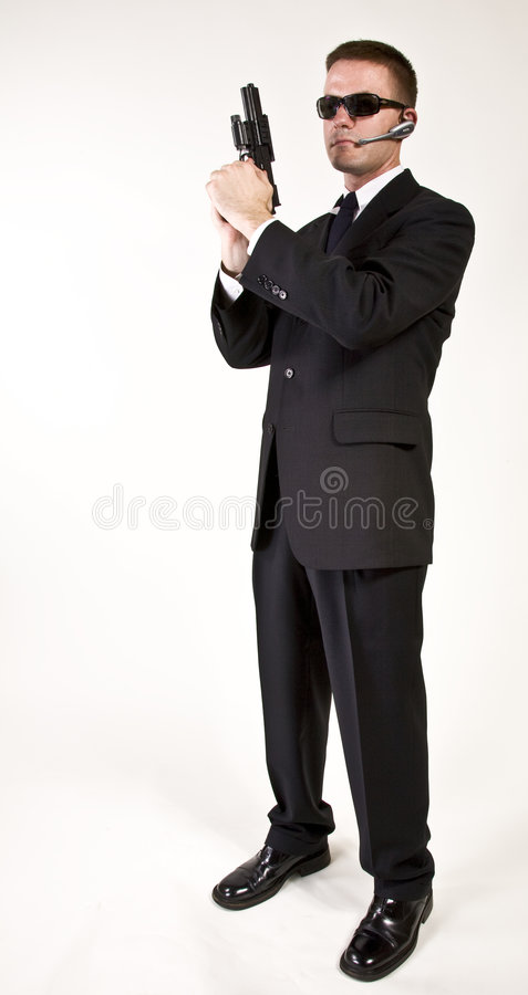 Geheimagent bewaffnet und gefährlich lizenzfreies stockbild