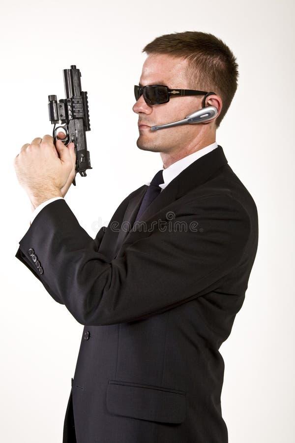 Geheimagent bewaffnet und gefährlich lizenzfreie stockfotos