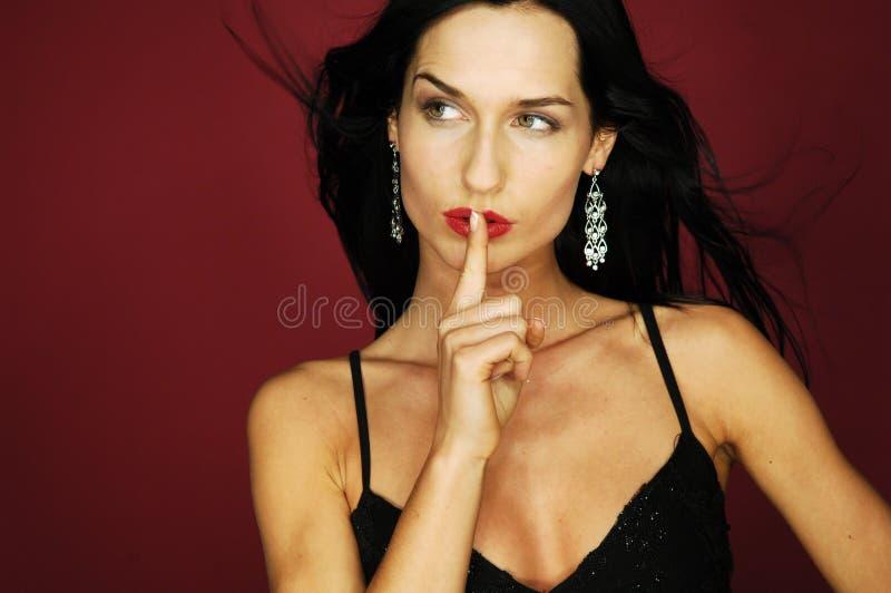 Geheime brunette stock foto