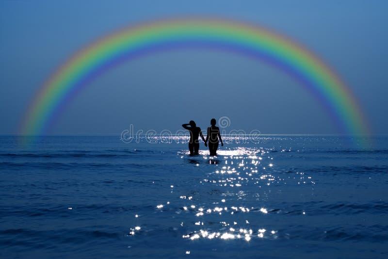 Geheime datum onder regenboog stock foto