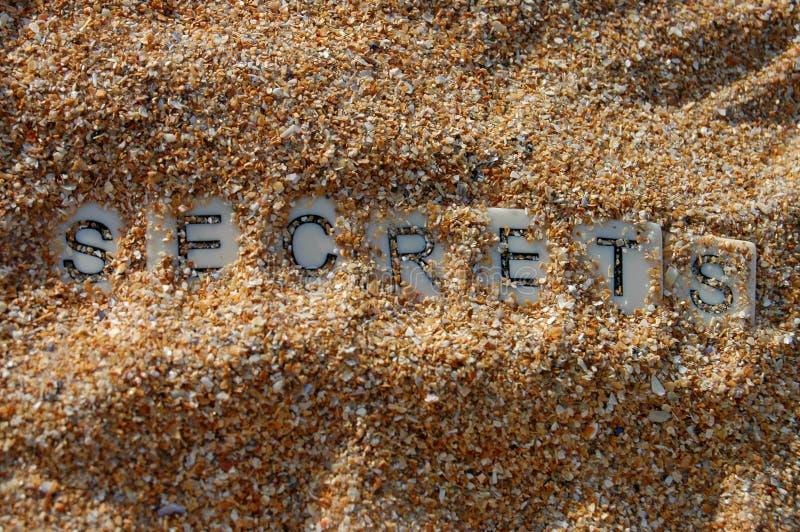 Geheimen in zand worden verloren dat royalty-vrije stock fotografie