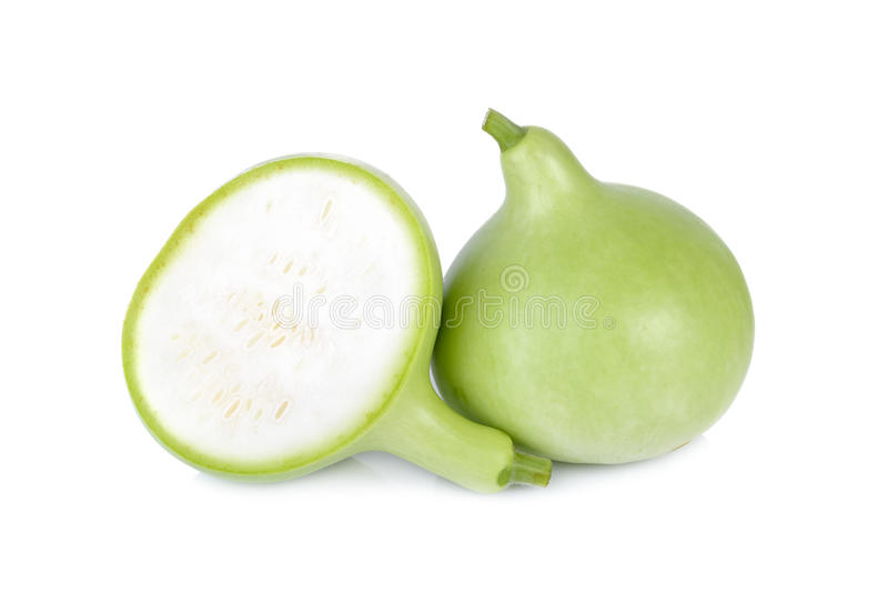 Gehele en halve besnoeiings groene kalebasboom op witte achtergrond stock fotografie