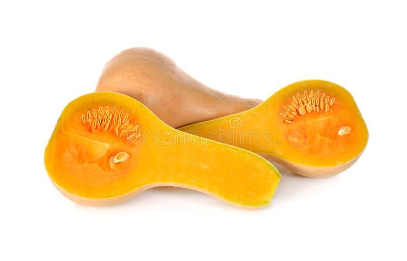 Gehele en halve besnoeiings verse pompoen butternut op witte achtergrond stock fotografie