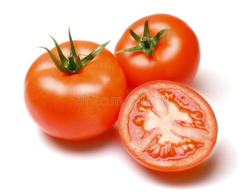 Gehele en Halve Tomaten stock foto's