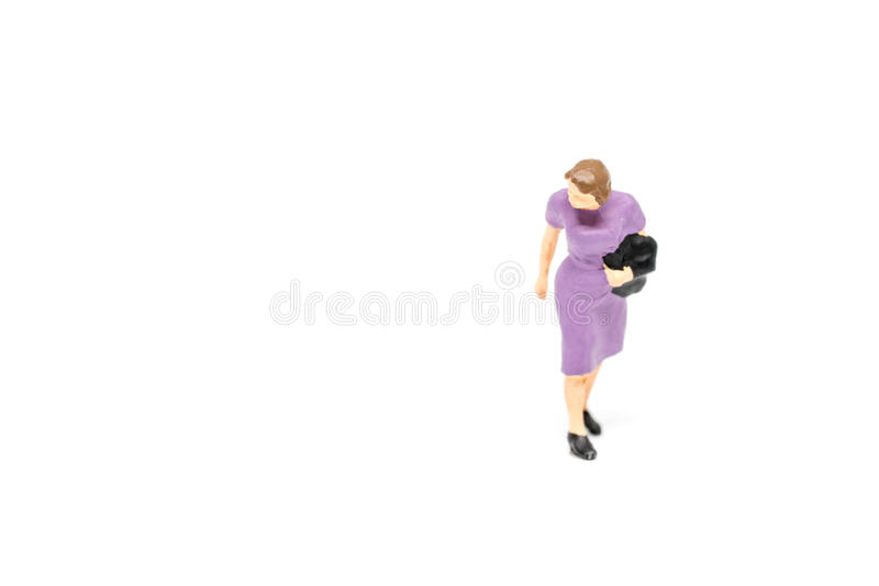 Gehendes Passagierkonzept der Miniaturleute auf Hintergrund mit a stockbild
