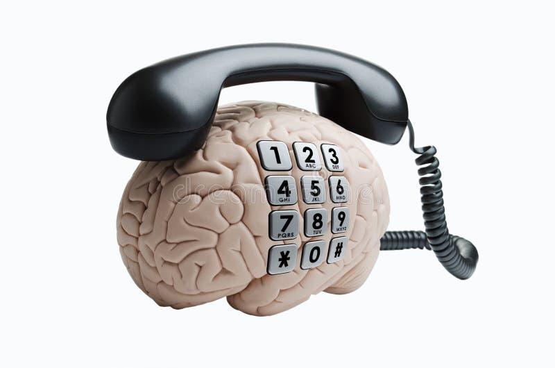 Gehirn mit Telefon lizenzfreie stockbilder