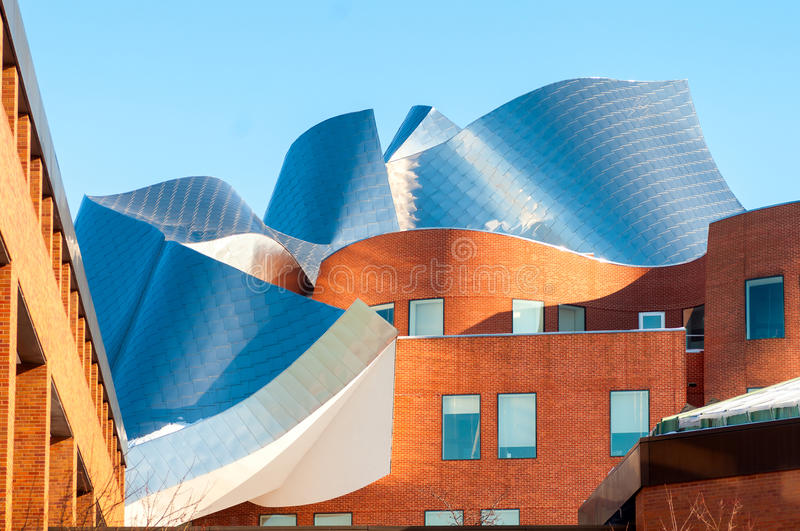 Gehry architecture. CLEVELAND, OH - FEBRUARY 28 2015: The Peter B. Lewis building, designed by renowned architect Frank Gehry, glistens in late afternoon royalty free stock images