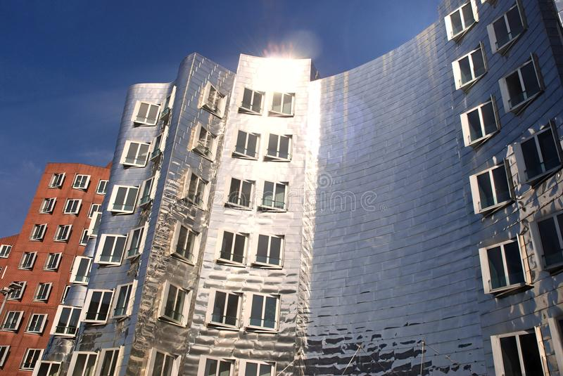 Futuristic Gehry houses in Medienhafen in Düsseldorf, germany. Gehry building in Medienhafen , a new part of Duesseldorf, Germany. In Medienhafen there are a stock photos