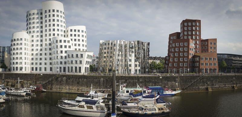 Gehry buildings. Düsseldorf, Germany - May 13, 2014: Der Neuer Zollhof (The New Zollhof), located at Neuer Zollhof 2 - 6, Unterbilk, is a prominent landmark stock images