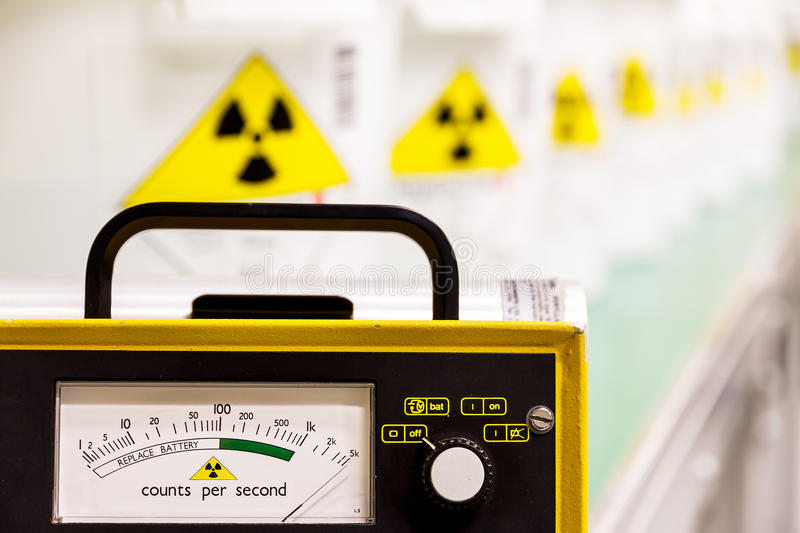 Geiger counter. With radioactive materials in the background stock photography