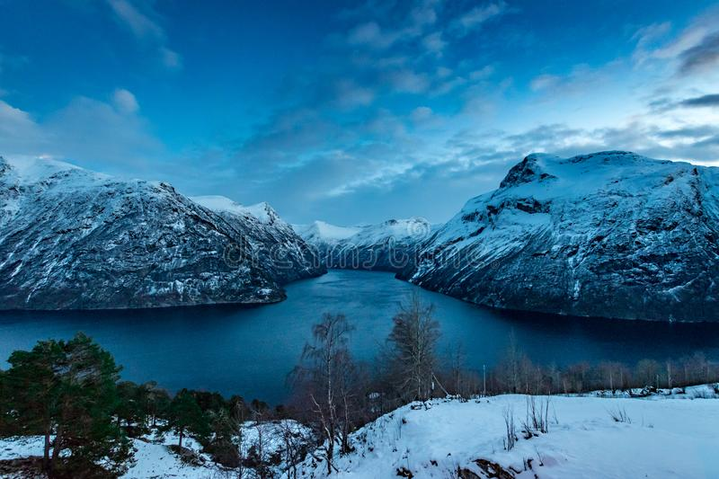 Geiranger fjord in winter snow landscape royalty free stock photo