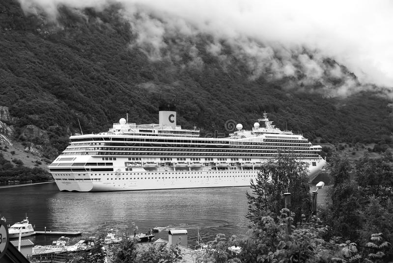 Geiranger, Norway - January 25, 2010: cruise ship in norwegian fjord. Travel destination, tourism. Adventure, discovery stock photography