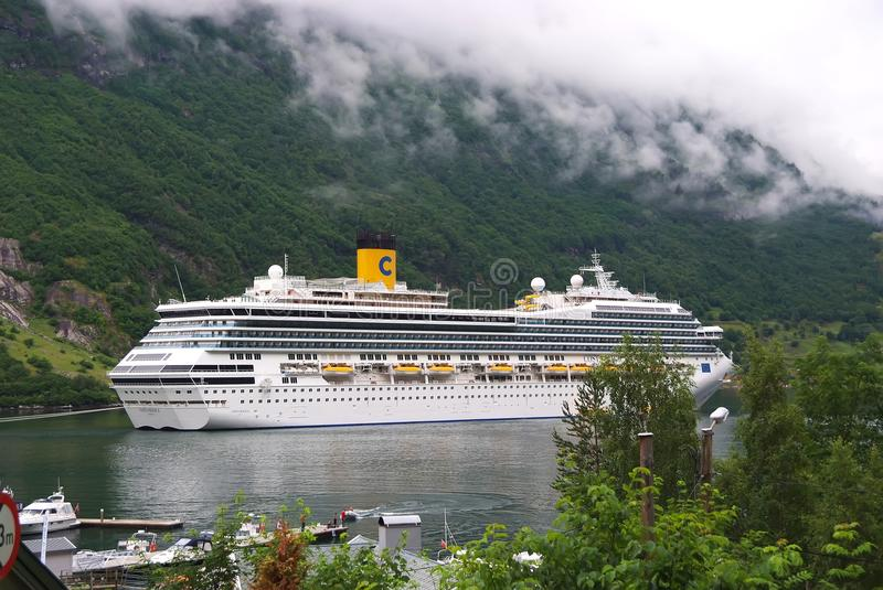 Geiranger, Norway - January 25, 2010: cruise ship in norwegian fjord. Travel destination, tourism. Adventure, discovery, journey. stock photo