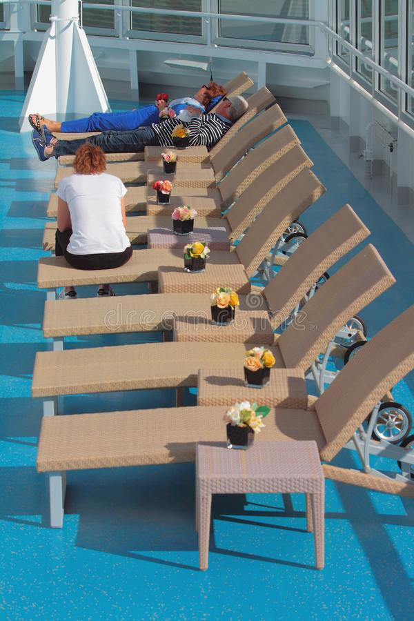 Geiranger, Norway - Jul 09, 2018: Tourists in lounge zone on deck of cruise liner royalty free stock photography