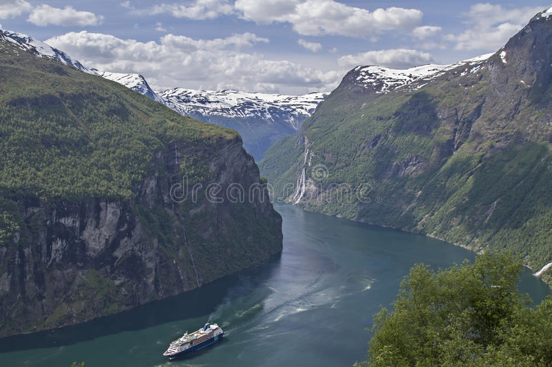 Geirangerfjord. Cruise ship in Geiranger Fjord - the epitome of Norwegian scenery and popular tourist destination royalty free stock photography