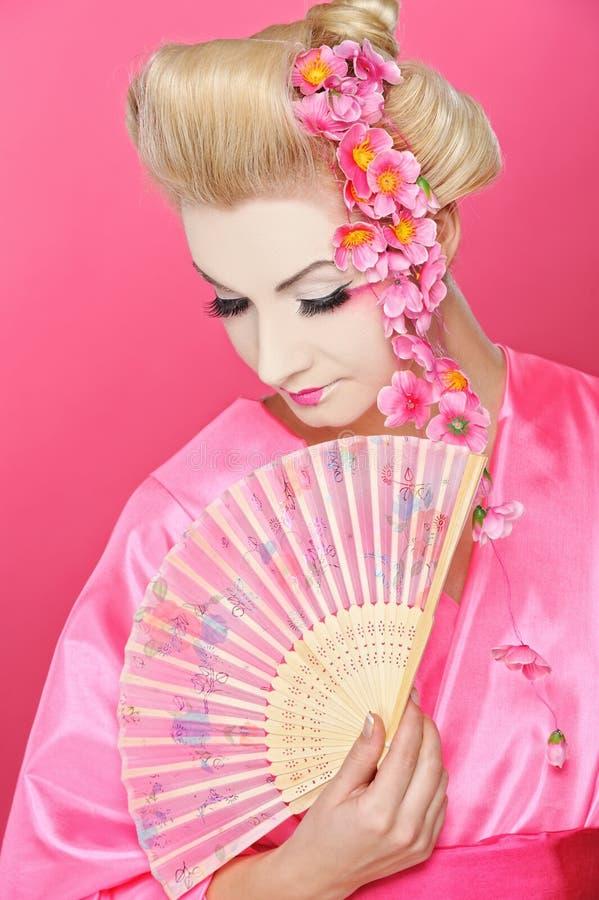 Geisha con un ventilador foto de archivo