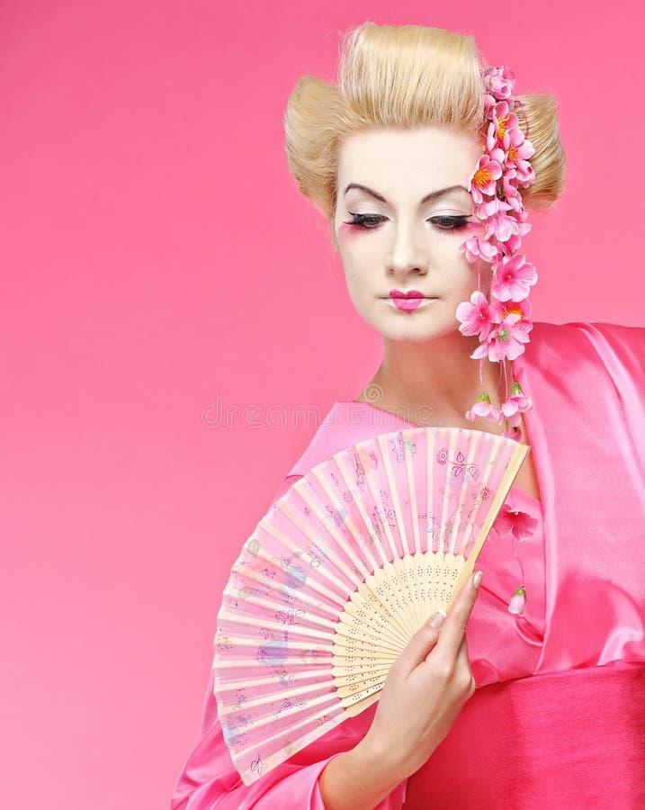 geisha con un ventilador imagen de archivo libre de regalías