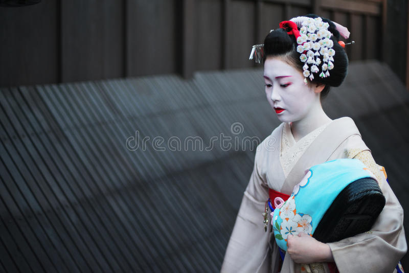 Geisha in Gion. Kyoto, Japan - April 8, 2013: Geisha approaching a famous tea house in the Gion district of Kyoto. The Geisha in Gion are the highest ranked in royalty free stock image