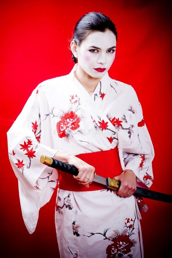 Geisha and katana sword stock image