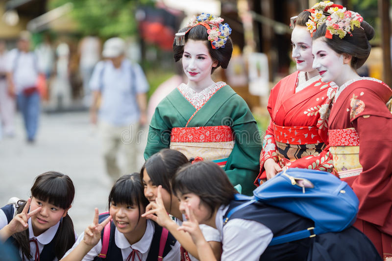 Geisha Maiko. KYOTO, JAPAN - JUNE 10: Unidentified tourist women dress like a Maiko and take photo with children, Tourists usually makeup as Geishas (also known royalty free stock photos