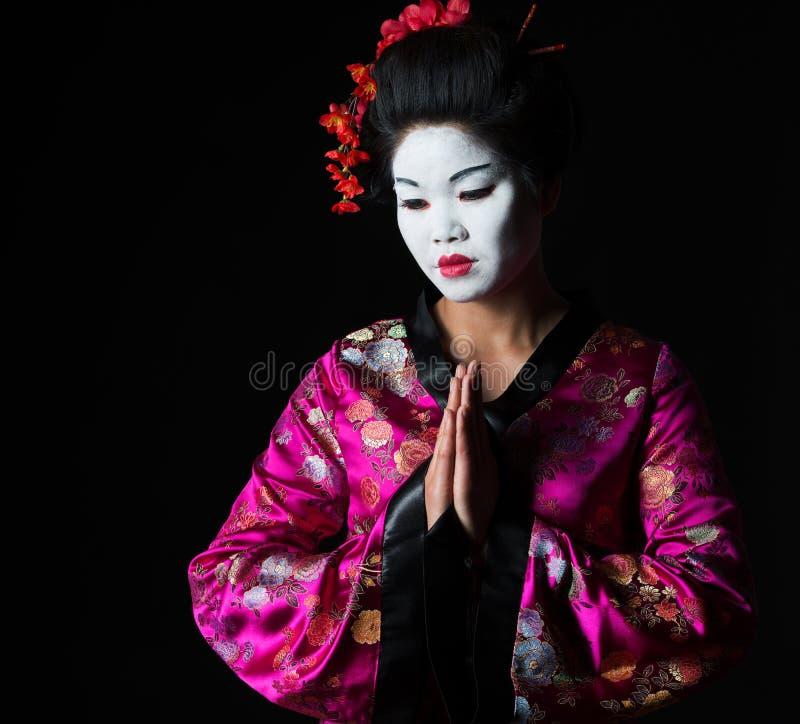 Geisha mit den Händen respektieren zusammen Geste stockfoto