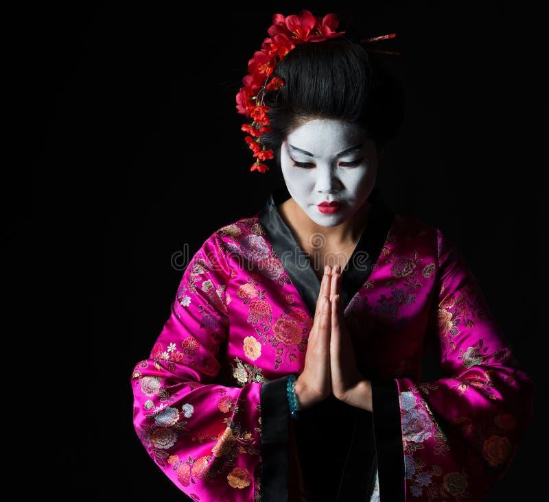 Geisha mit den Händen respektieren zusammen Geste stockfotos
