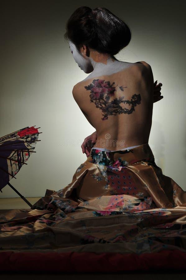 Geishatatuering fotografering för bildbyråer