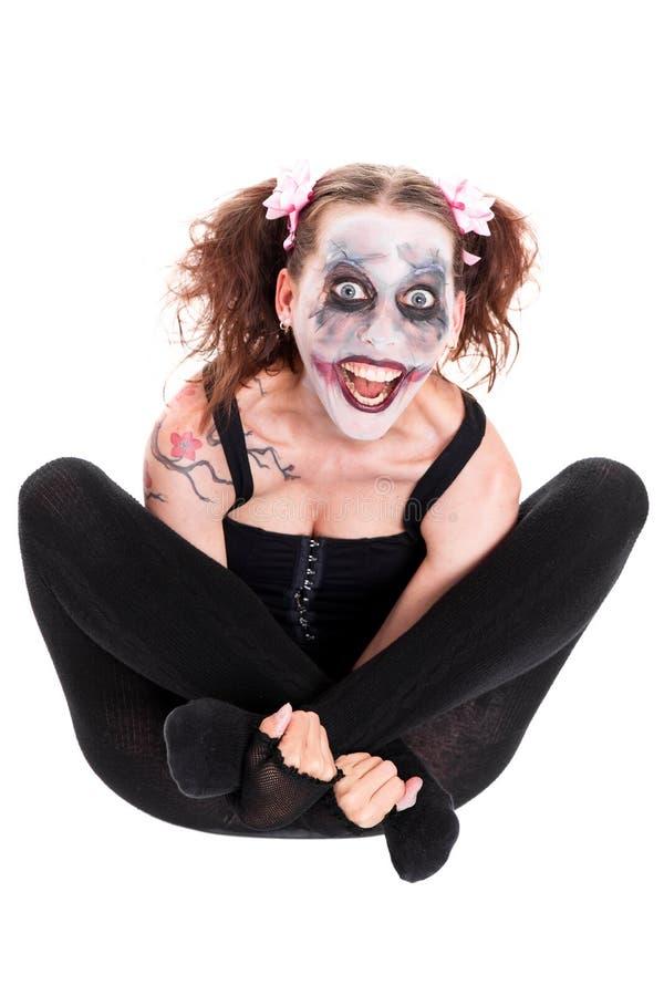 Geisteskranker weiblicher Clown vor Weiß lizenzfreies stockfoto